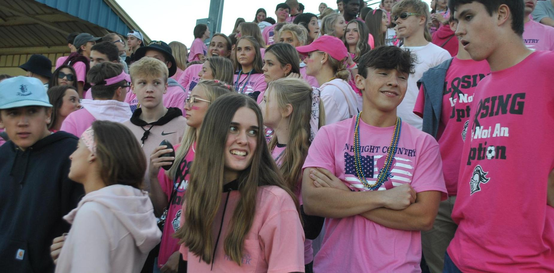 Students in student section at football game