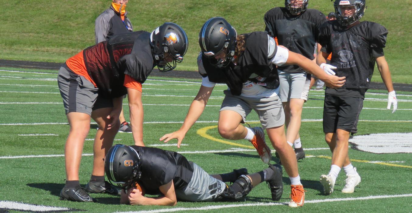 TKHS football players practice.
