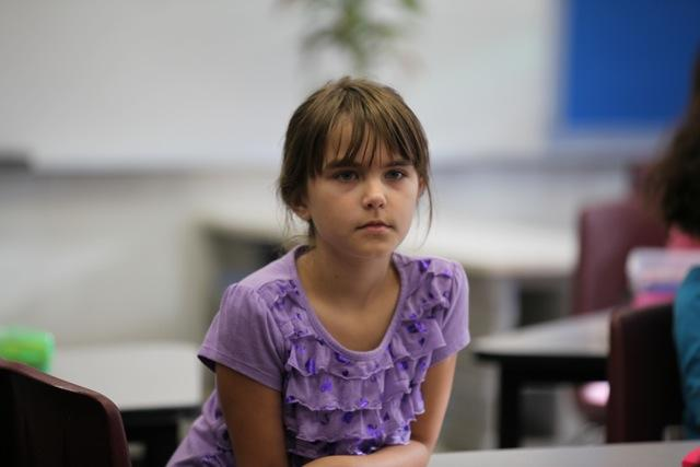 girl looking serious in class