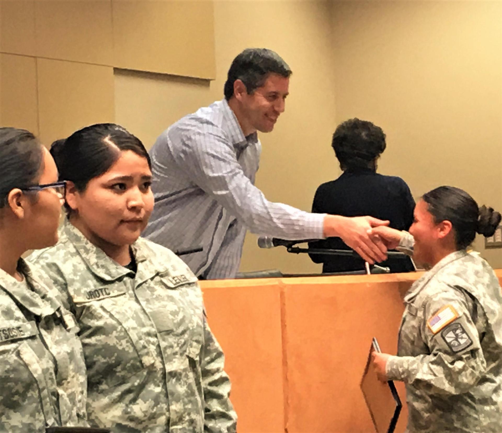Superintendent Mr. Hyatt congratulating a JROTC Cadet