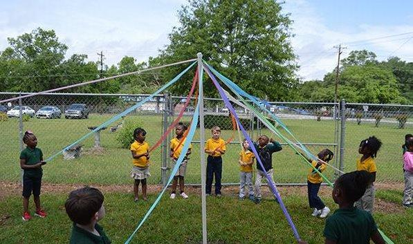 Students create a May pole