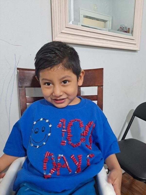 Boy wearing blue 100 days shirt