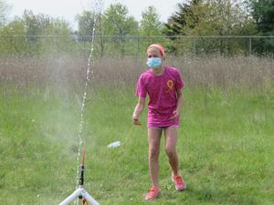 A Page 5th grader launches her rocket.