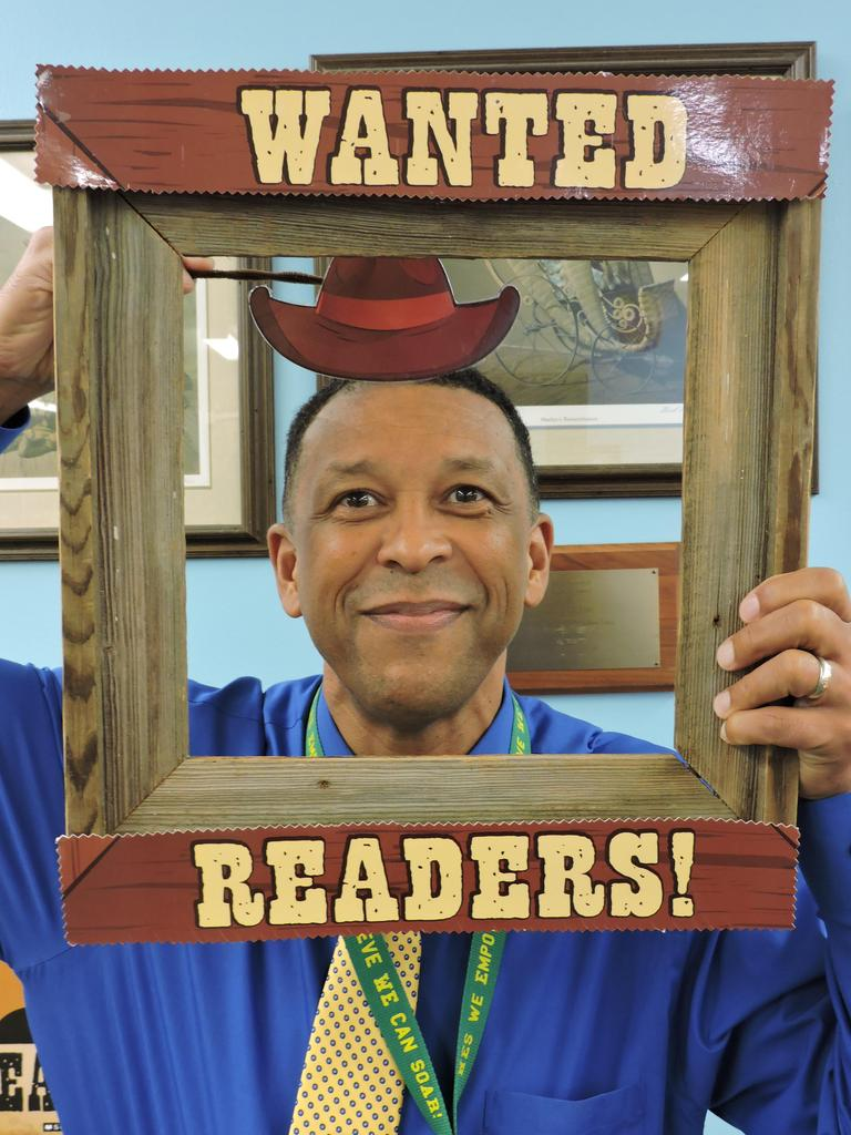 Principal with Wanted Readers picture frame