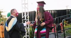 2021 graduation student and principal