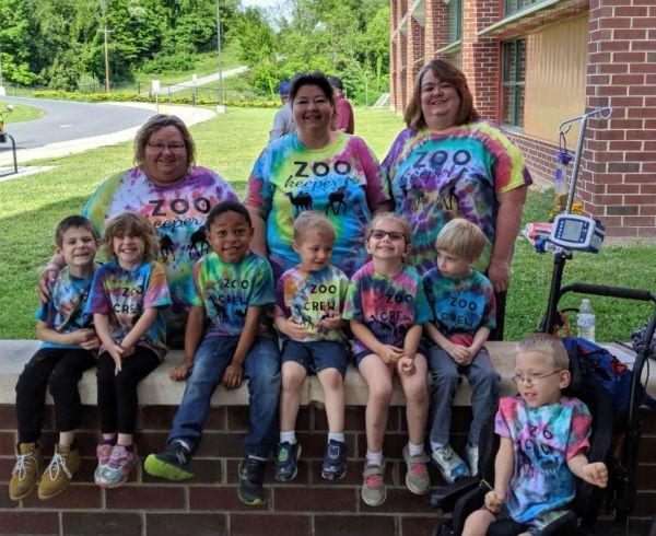 Students and Staff wearing matching tie dye t-shirts