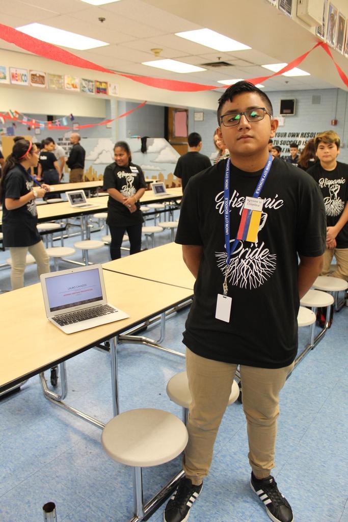 boy with presentation on lauro cavasos