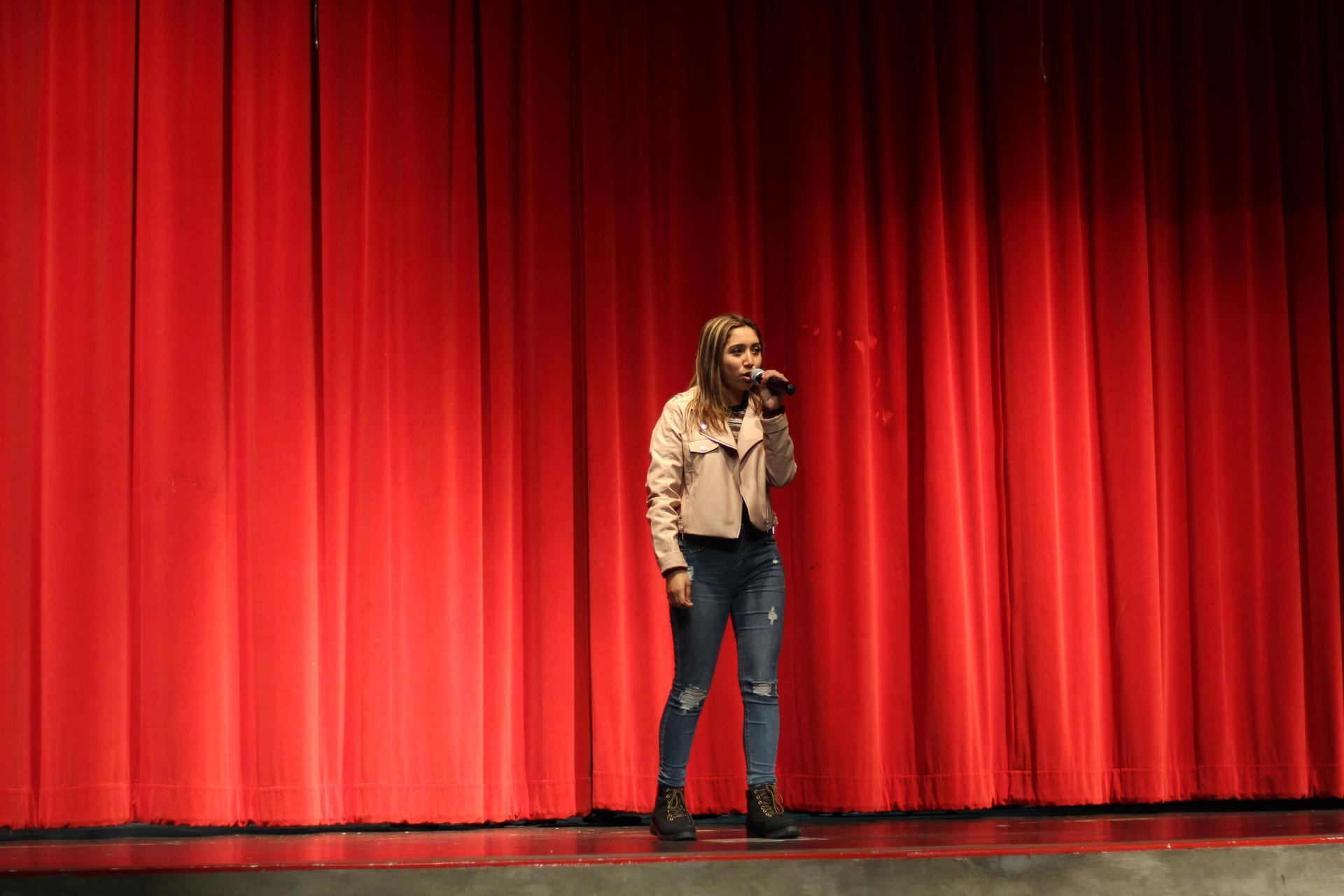 Sophia Atilano performs her part of a duet with Michael Eggert at the NSL Talent Show.