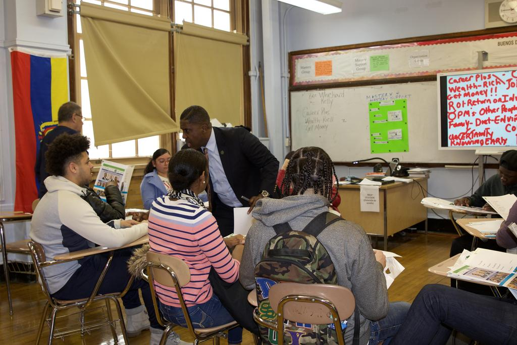 teacher explaining career day lesson to students