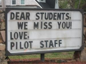 School sign telling students they are missed by Pilot's staff.