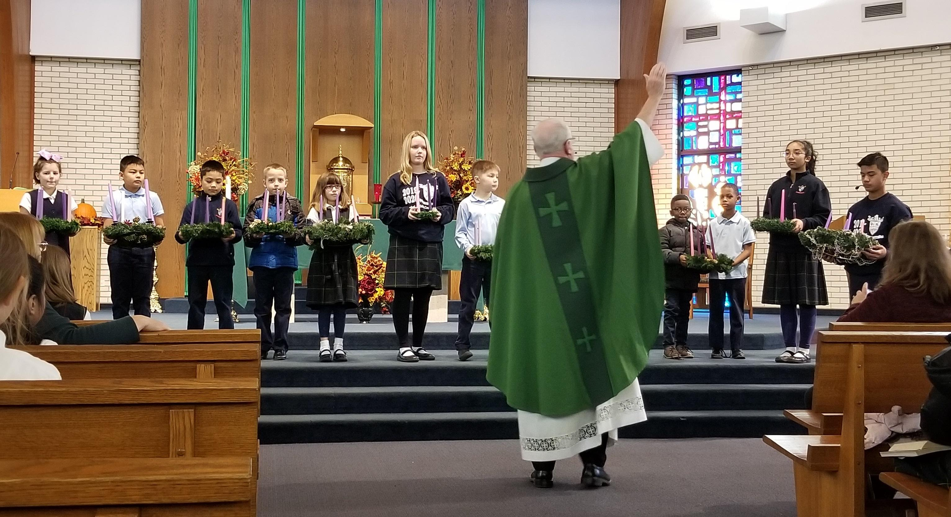 Father blesses wreaths