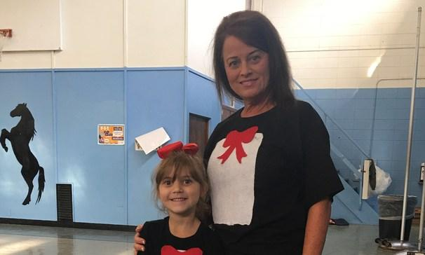 Pre-K teacher with student