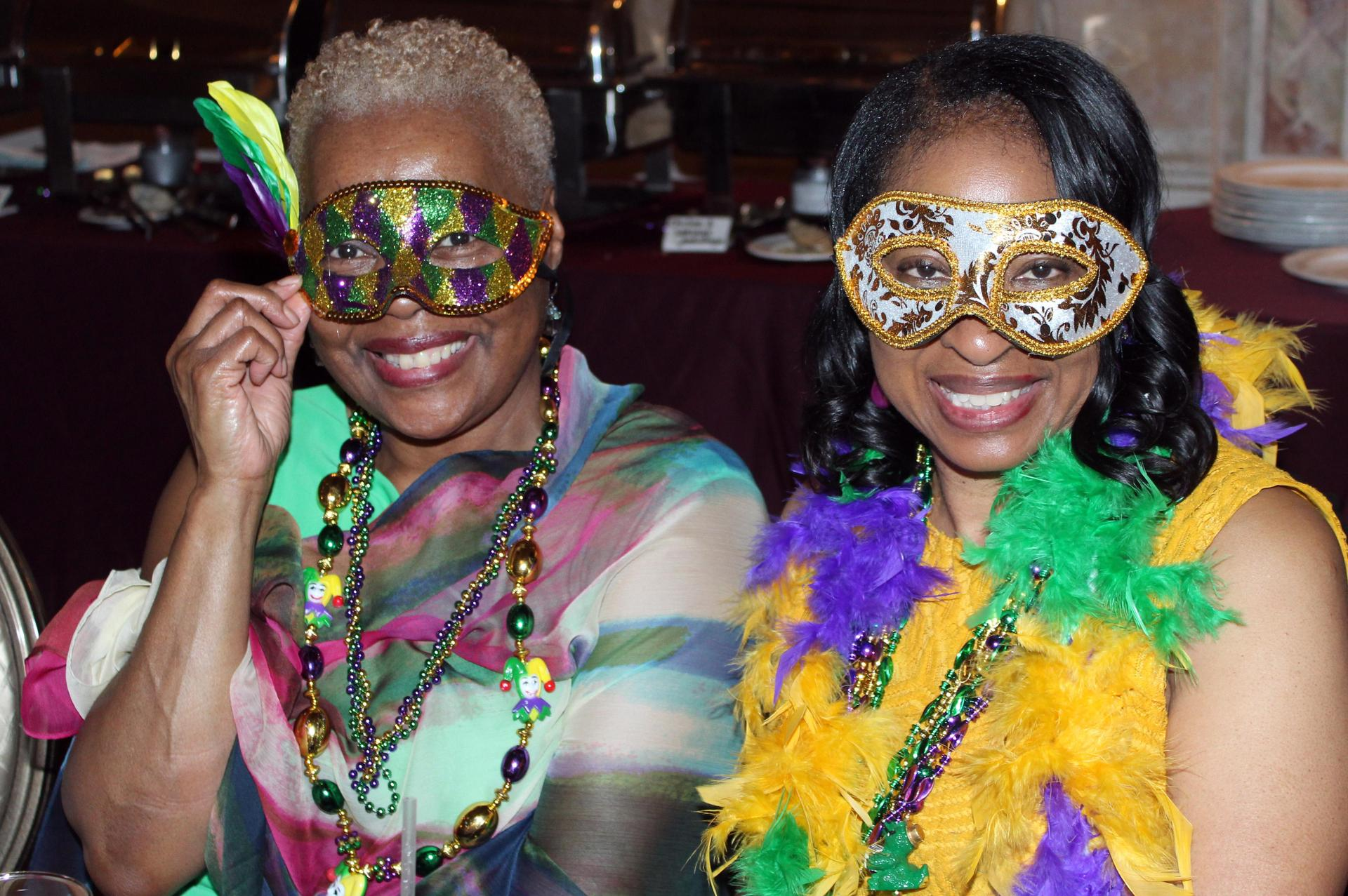 Two ladies in Mardi Gras masks
