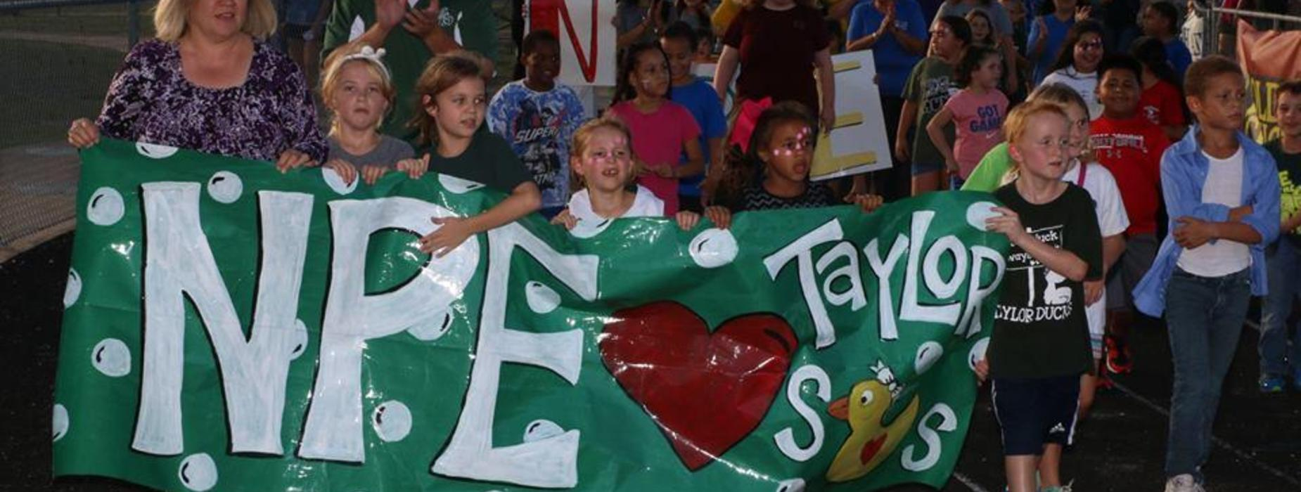NPE banner with students