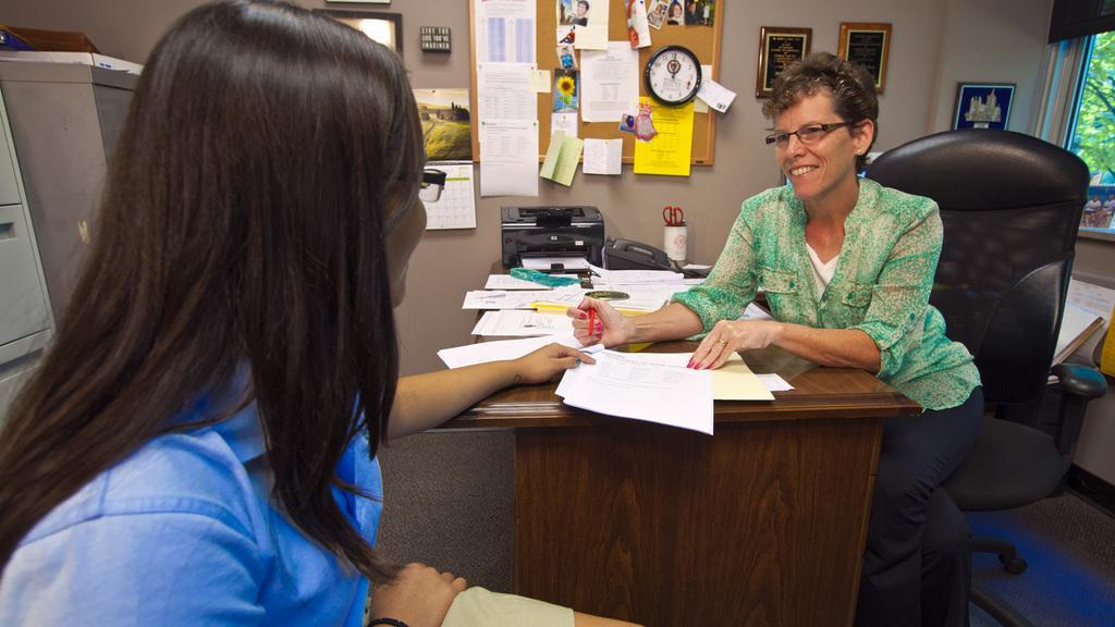Mrs. Judy Caves, Guidance Counselor, assisting a student