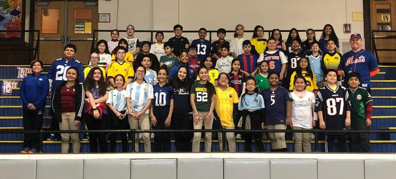 students wearing their team jerseys in the gym
