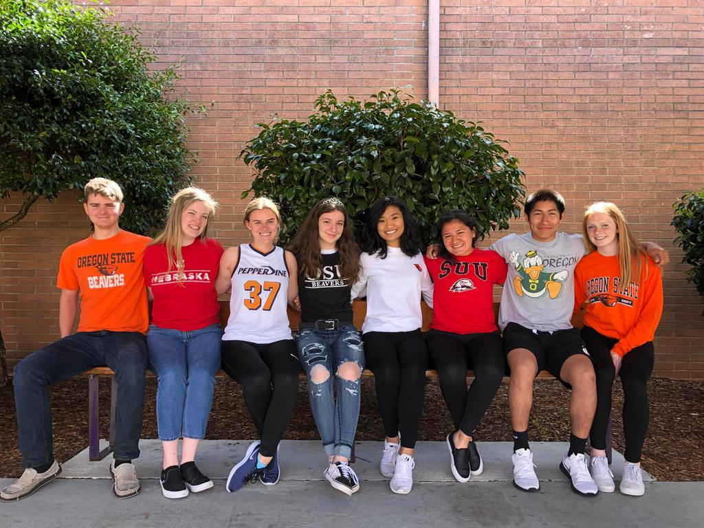 Students with college shirts on