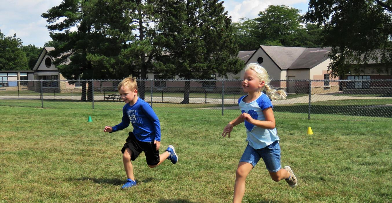 McFall students race to the other side in a PE game.