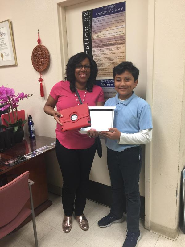 Ms. Murray Presents iPad to Attendance Lottery Winner 2018 Featured Photo