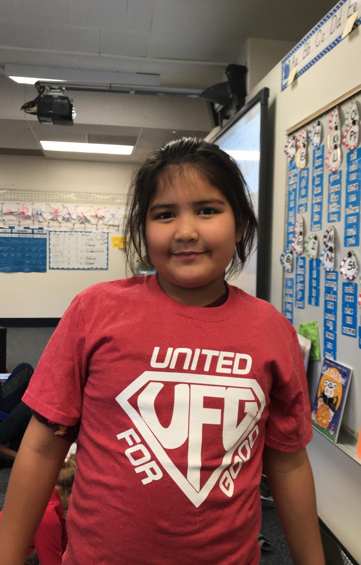 2nd grade girl supporting UNITED FOR GOOD.