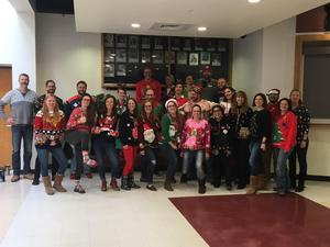 Group photo of DHS teachers and staff in holiday outfits