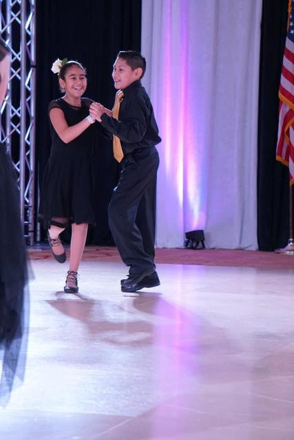 boy and girl dancing and laughing