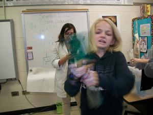 A student participates in a science experiment.