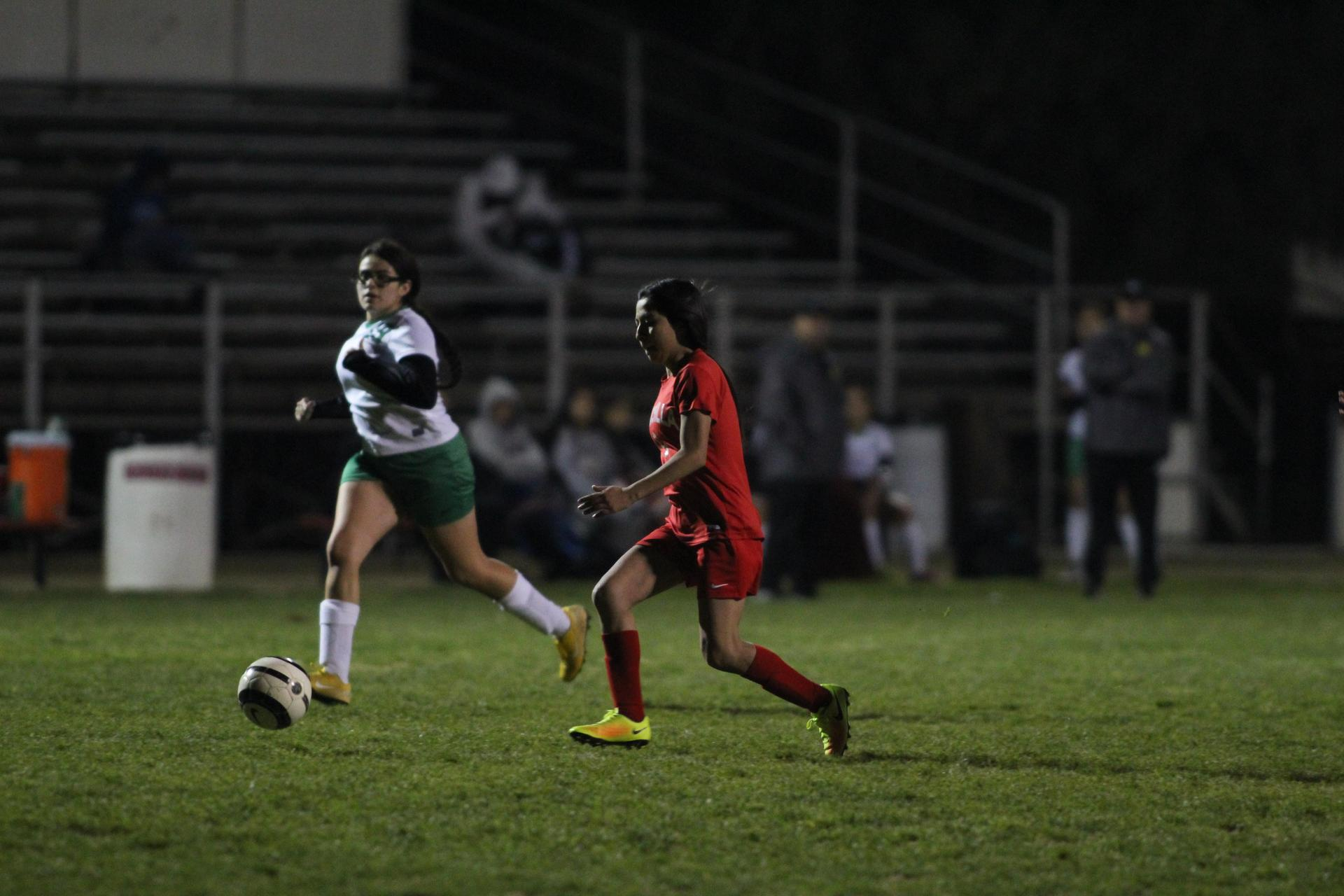 Girls playing soccer against Roosevelt