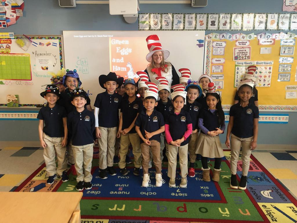kindergarten teacher dressed as the Cat in the hat with her students wearing wacky hats