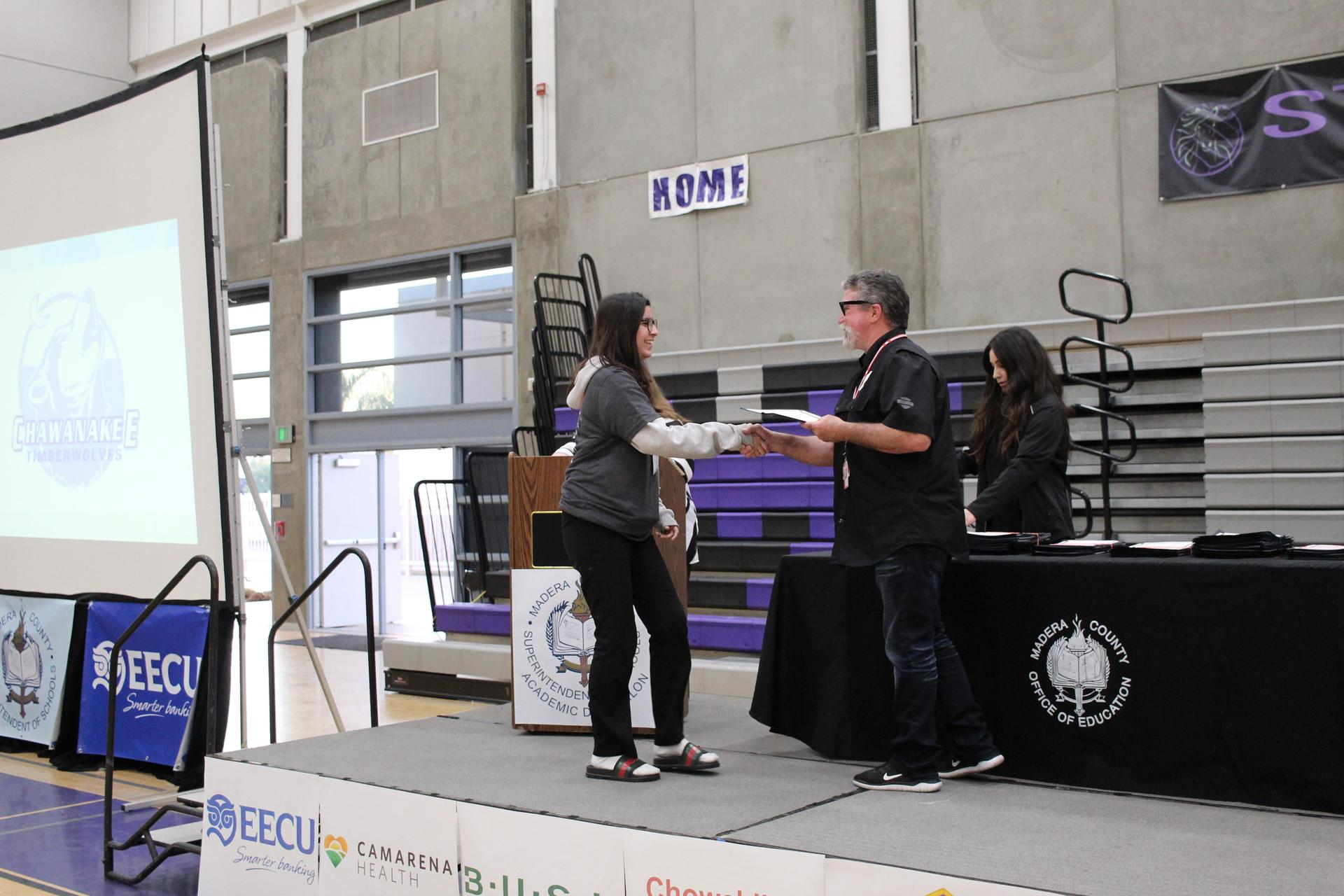 Arely Baez gets participation award from CUHSD Superintendent Ron Seals