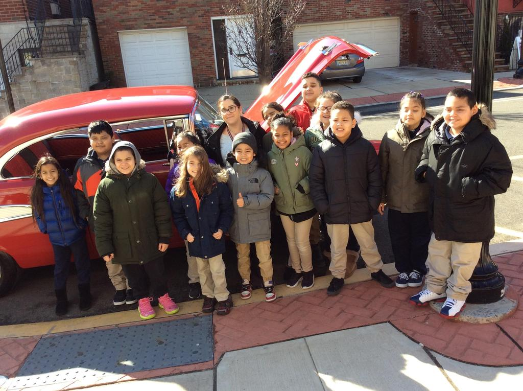 4th Grade class standing in front of the 57 Chevy