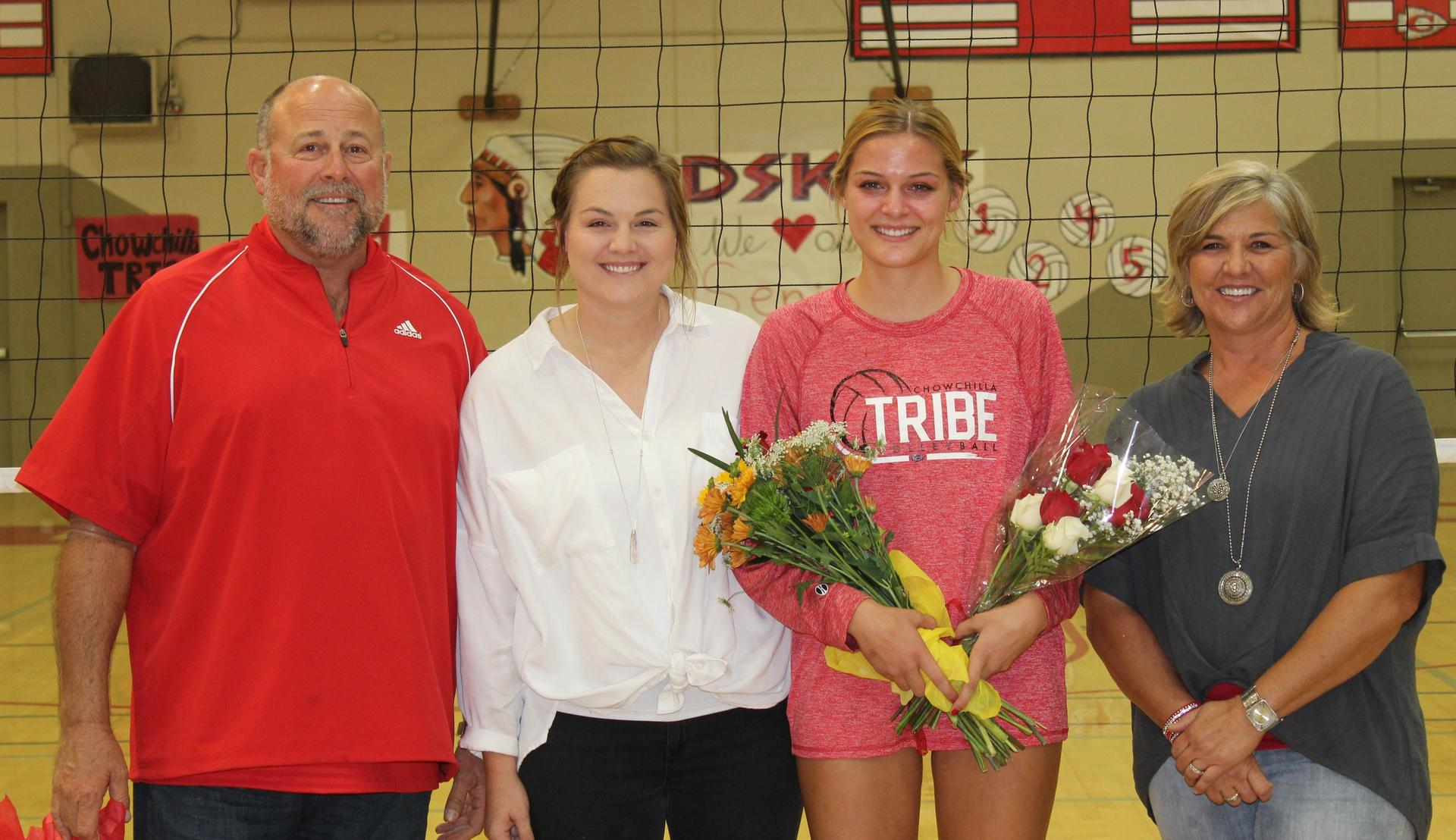 Kinsley Vlot, Coach Samantha Vlot and their parents on Volleyball Senior Night.