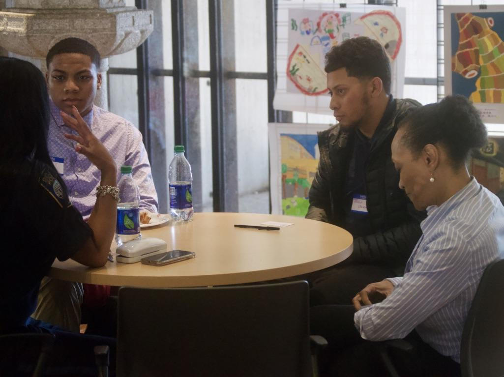 Two Snowden students sit for a meeting with their mentors.
