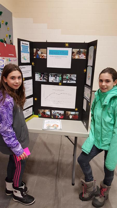 5th Grade Students with their project at the Science Fair