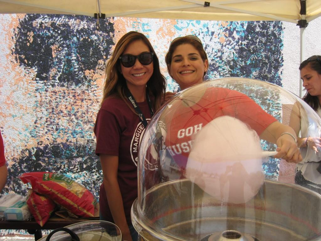 PTA members in front of the cotton candy machine