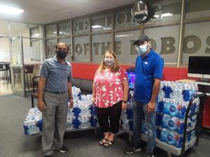 Cody Satterfield Sam from Aurora Stores Water Donation