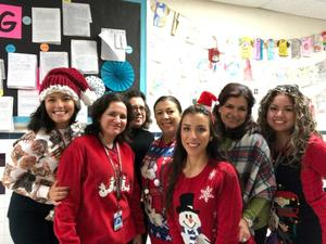 group of 5th grade teachers wearing ugly xmas sweaters