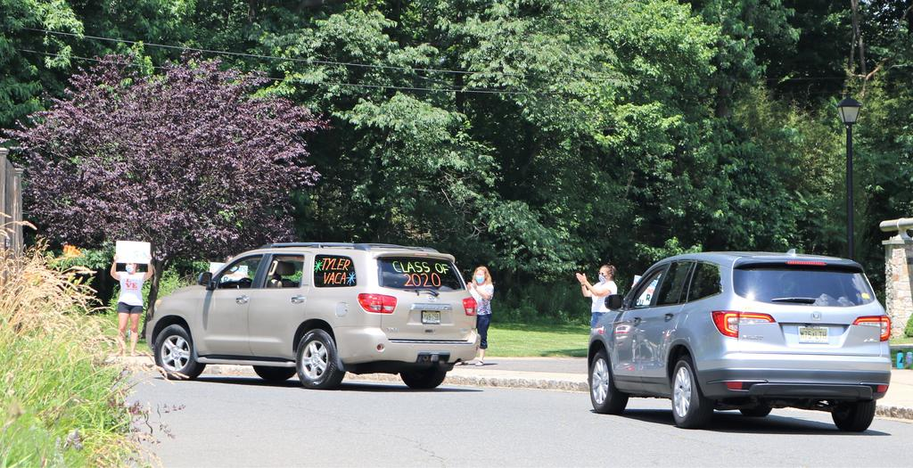 Photo of Tamaques Grade 5 teachers clapping for 5th graders passing by in car parade.