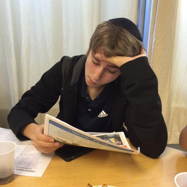 Reading a Hebrew newspaper