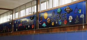Ten new murals adorn the Washington School gymnasium, thanks to a creative collaboration of 5th graders, parents, teachers, WHS graphic design students, the Westfield Coalition for the Arts, and a local graphic arts company.