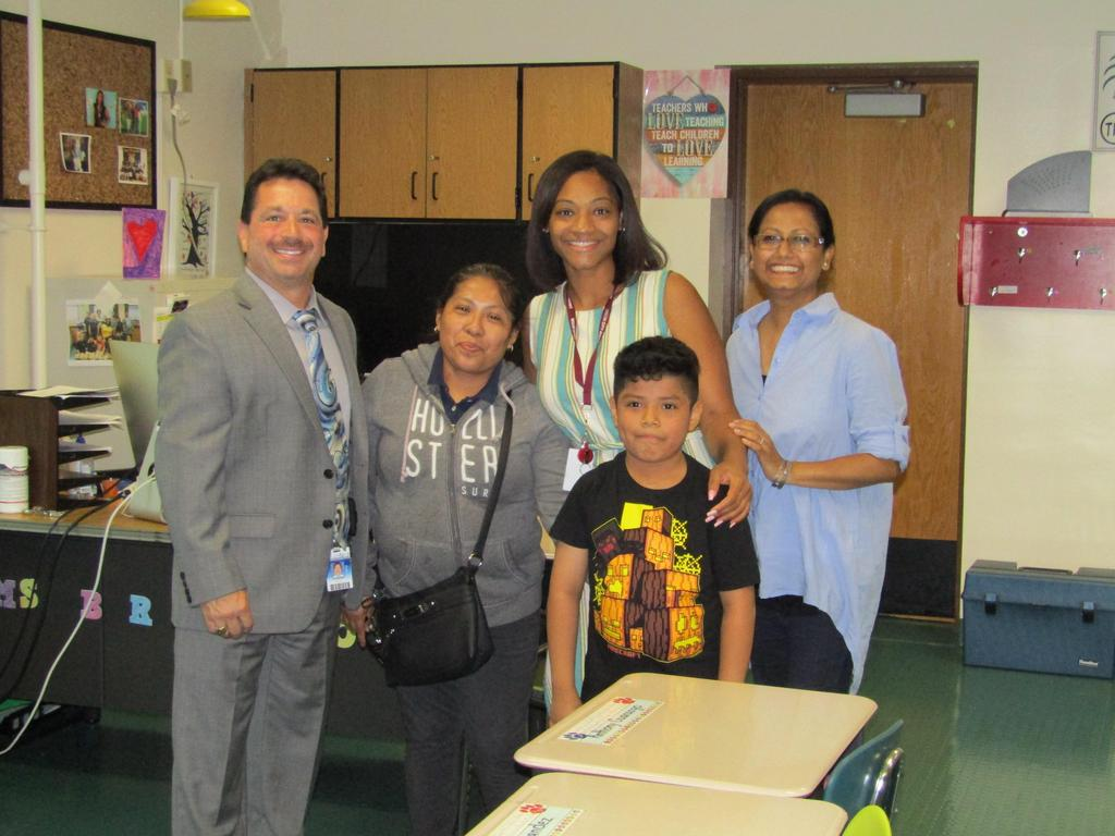 Principal Celebrano with student and family