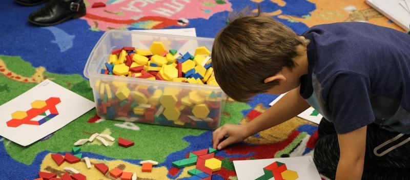 Boy using shape blocks