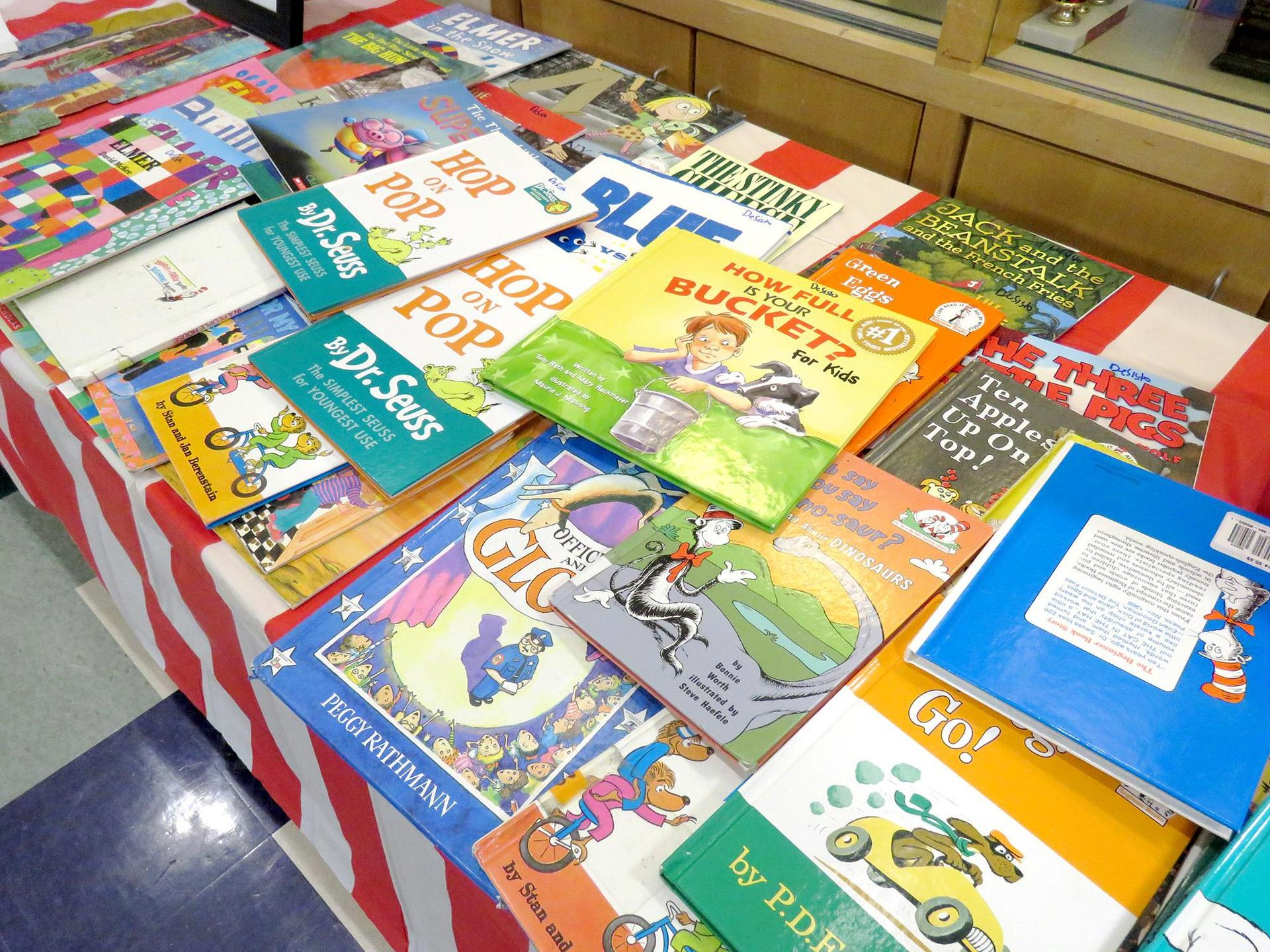 A table filled covered with children's books