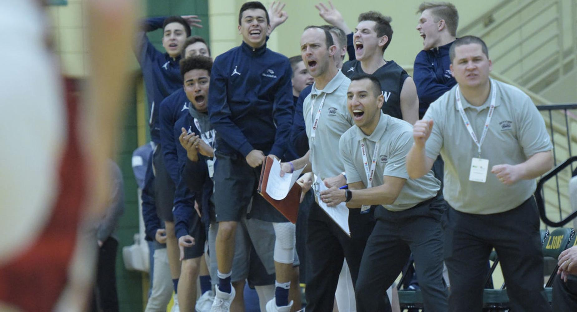 Basketball team and coach jump and cheer at sidelines