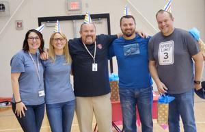 HMS food pantry team.  5 people in party hats.