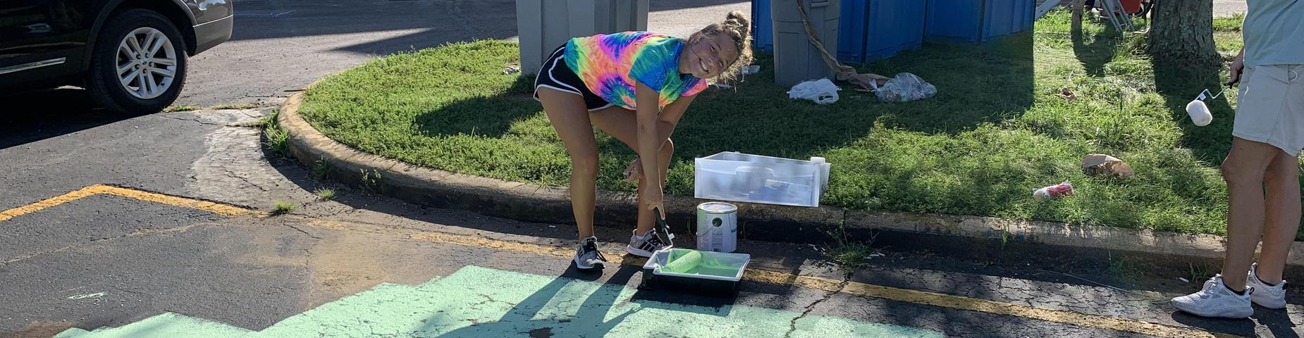MHS students painted their parking spots for being CCR by the beginning of their Senior year.