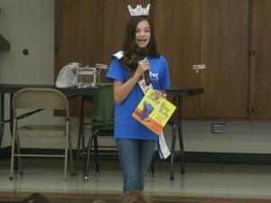 Allie Ingram reading anti-bullying book to students and staff