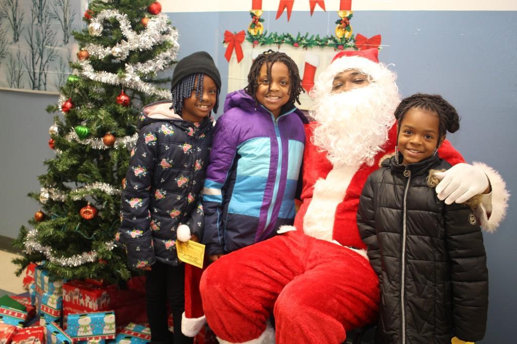 Three girls with Santa