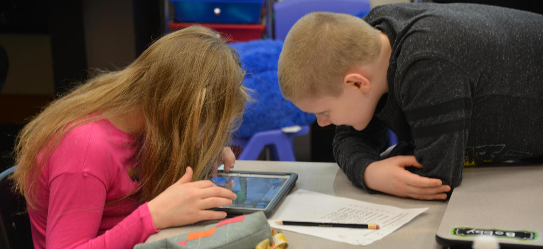 students looking at ipad together