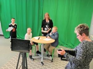 The Lee Elementary broadcast includes news, weather, and sports.